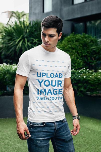 Transparent T-Shirt Mockup Featuring a Serious-Looking Man at a Garden 429-el