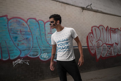 Transparent Tshirt Mockup of a Man with Spooky Makeup Against a Wall with Graffiti 23027