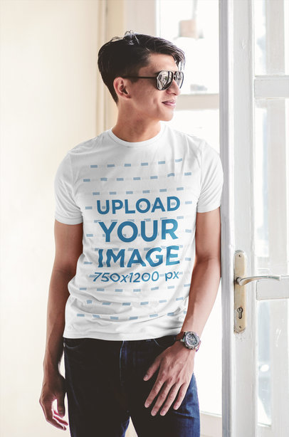 Transparent T-Shirt Mockup of a Man with Sunglasses Standing by a Window 43328-r-el2