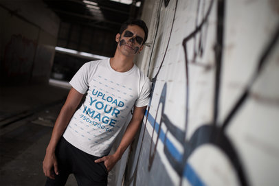 Transparent T-Shirt Mockup of a Man with Scary Halloween Makeup Against a Graffiti 23025
