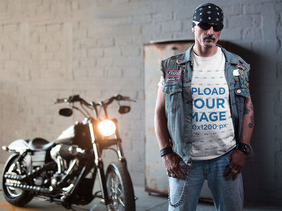 Transparent Mockup of a Tattooed Biker Man Wearing a T-Shirt Bandana and Chain In Front of a Motorcycle 20246