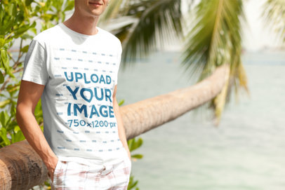 Transparent T-Shirt Mockup of a Young Man Posing by the Beach 2752-el1