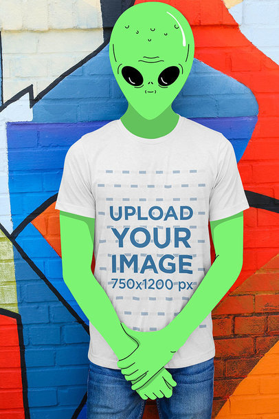 Transparent Illustrated Mockup of a Green Alien Wearing a T-Shirt in an Urban Scenario 3179-el1