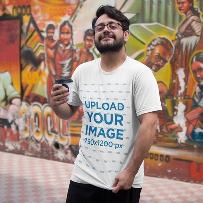 Transparent Happy Customer Showing his T-Shirt Mockup While in an Urban Area a16218