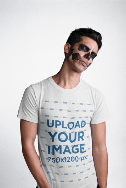 Transparent Mockup of a Man Wearing a T-Shirt and Serious Skeleton Halloween Makeup 22938