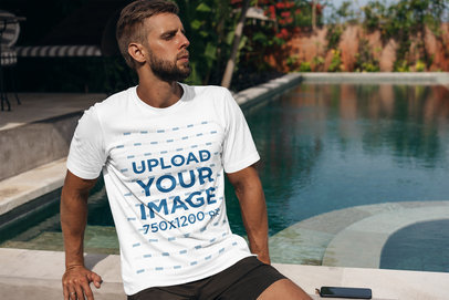 Transparent T-Shirt Mockup of a Bearded Man Sitting by a Pool 4348-el1