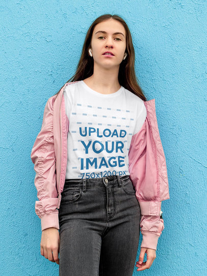Transparent T-Shirt Mockup of a Young Woman Leaning on a Blue Wall 45075-r-el2
