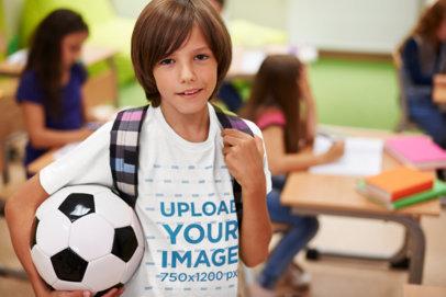 Transparent T-Shirt Mockup Featuring a Boy Carrying a Soccer Ball at School 38245-r-el2