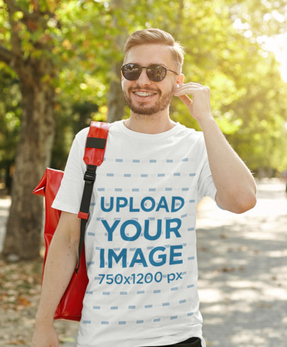 Transparent T-Shirt Mockup of a Bearded Man with Braces Walking at a Park M1314-r-el2
