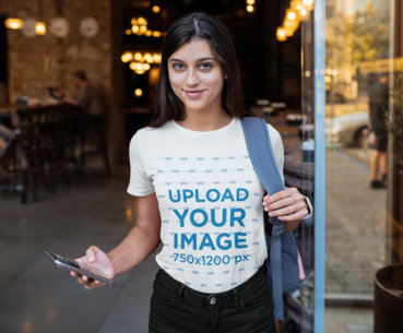 Transparent T-Shirt Mockup Featuring a Young Woman Holding Her Phone 41396-r-el2