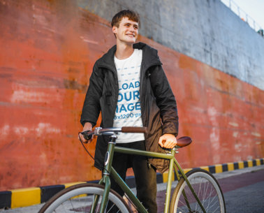 Transparent T-Shirt Mockup of a Happy Young Man Posing With a Bike 43189-r-el2