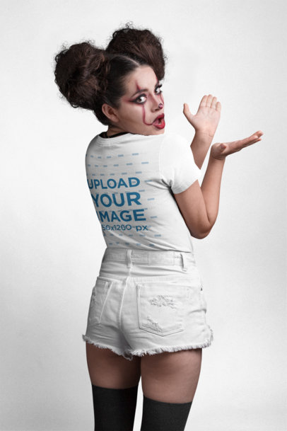Transparent Back View T-Shirt Mockup of a Girl with Spooky Halloween Makeup at a Photo Studio 22917