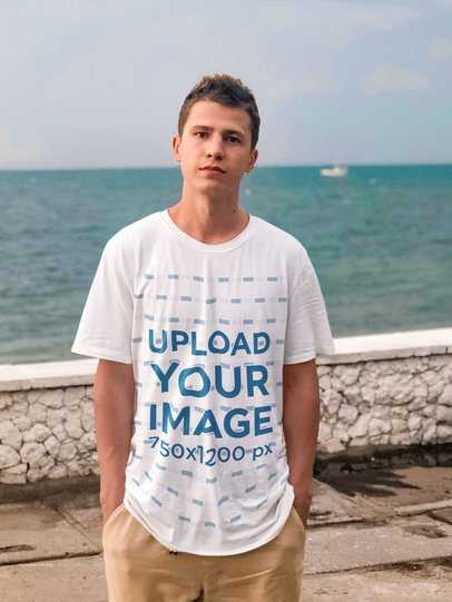 Transparent Mockup of a Young Man Wearing a Loose T-Shirt by the Ocean m1572-r-el2