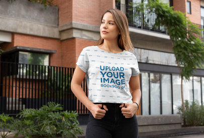 Transparent Sublimated Crop Top Mockup Featuring a Young Woman on a Street 28553