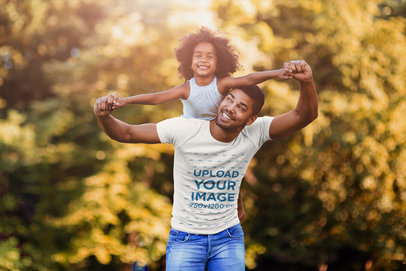 Transparent Tee Mockup of a Father Carrying His Daughter on His Back 42237-r-el2