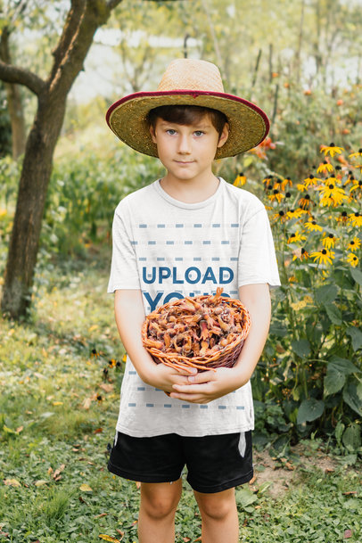 Transparent Mockup of a Kid with a T-Shirt Holding a Basket of Chestnuts 35514-r-el2