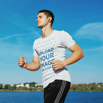 Transparent Activewear Mockup of a Man Wearing a Heathered T-Shirt While Jogging by a Lake 44762-r-el2