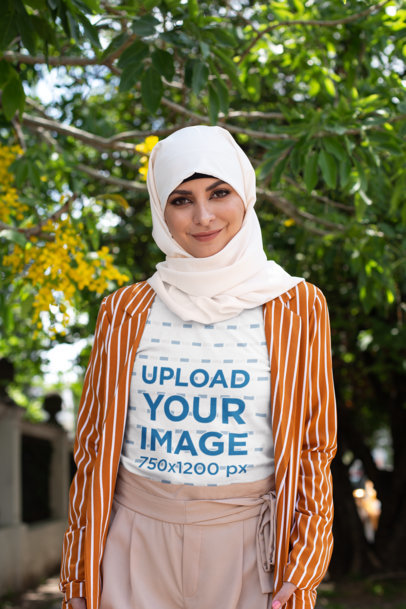 Transparent T-Shirt Mockup of a Woman with a Hijab Posing Under a Tree 28294