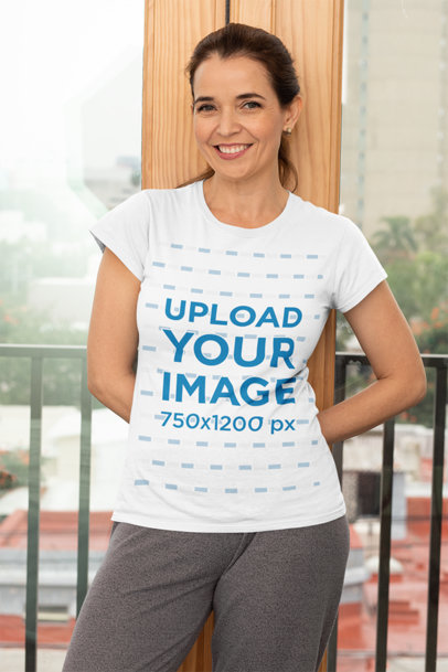 Transparent T-Shirt Mockup Featuring a Middle-Aged Woman Standing Against a Balcony Door 31606