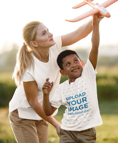 Transparent T-Shirt Mockup of a Happy Kid Playing With an Airplane Toy m1351-r-el2
