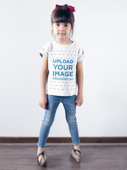 Transparent Little Girl Wearing a T-Shirt Mockup Against a White Wall a19465