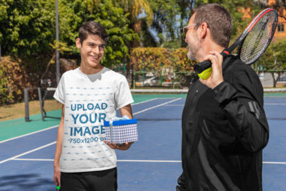 Transparent T-Shirt Mockup of a Man Giving a Present to His Dad After a Tennis Match 33109
