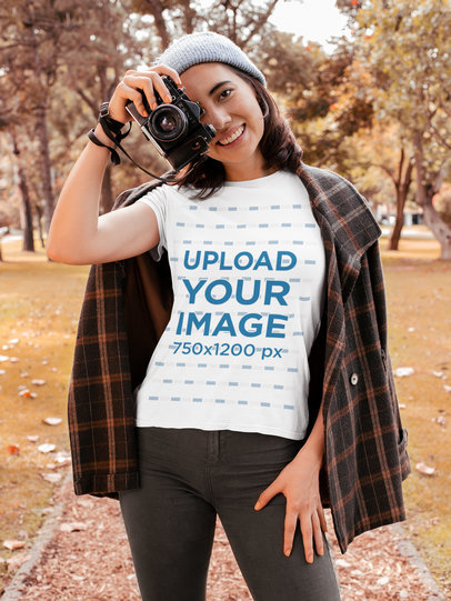 Transparent T-Shirt Mockup of a Young Woman Taking Pictures at a Park 30118