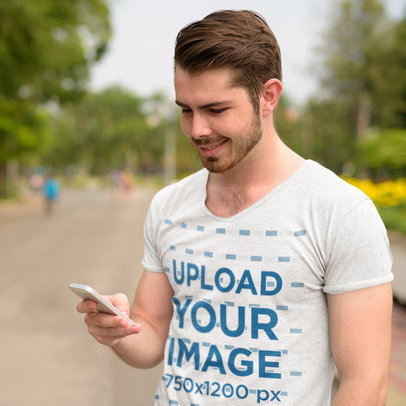 Transparent T-Shirt Mockup of a Man Checking His Phone on the Street 44412-r-el2