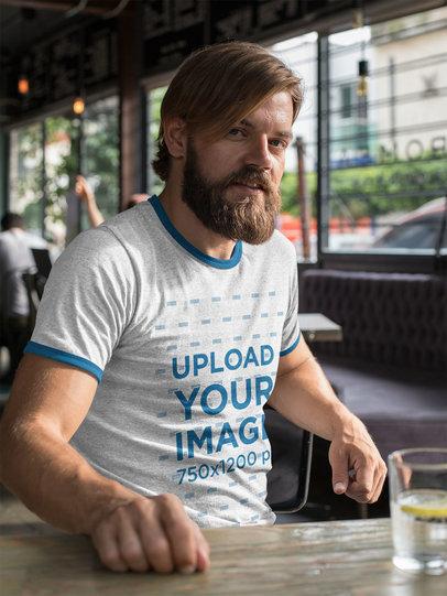 Transparent Ringer T-Shirt Mockup of a Man at a Restaurant 27918