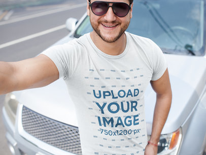 Transparent Smiling Middle Aged Dude Wearing a Tshirt Mockup While Near a Car a15997