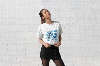 Transparent Tee Mockup of a Stylish Girl Standing Under the Sun with Her Eyes Closed 25786