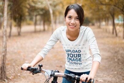 Transparent 3/4 Sleeve Tee Mockup of a Happy Woman Riding a Bike 42464-r-el2