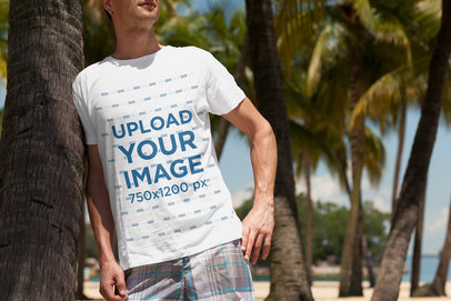 Transparent T-Shirt Mockup of a Man at the Beach Leaning on a Palm Tree 2750-el1