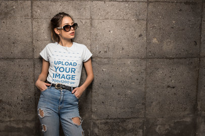 Transparent Mockup of a Cool Woman Wearing a Tee and Jeans Against a Stone Wall 24644
