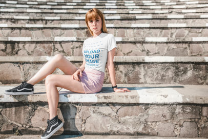 Transparent Mockup of a Beautiful Strawberry Blonde Haired Girl Sitting on Stone Steps 20130
