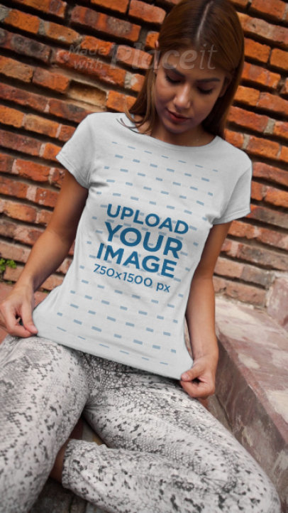 T-Shirt Video Featuring a Woman and a Brick Wall in the Background 3712v