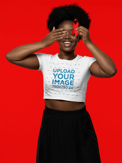 Crop Top Mockup Featuring a Woman Holding a Red Ribbon in Support of AIDS Awareness Day m17197