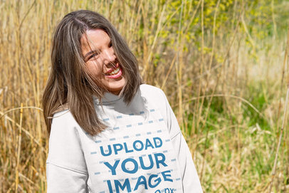 Hoodie Mockup Featuring a Woman and Some Greenery in the Background m15813-r-el2