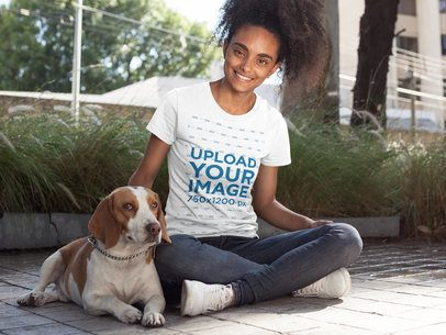 Girl Wearing a Tshirt Mockup while Petting her Dog a17839