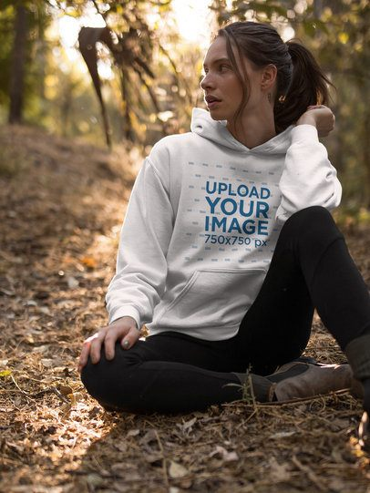 Girl Resting in the Woods Wearing a Pullover Hoodie Mockup a17907