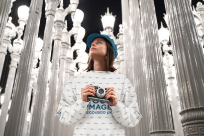 Mockup of a Young Woman with a Sublimated Sweatshirt and a Camera 36283-r-el2