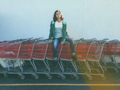 Woman Sitting on Shopping Carts Wearing a T-Shirt Mockup a18474