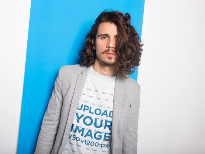 Long Haired Man Wearing a T-Shirt Mockup and a Gray Blazer a18522