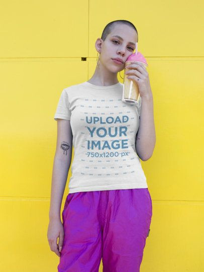 Mockup of a Shaved Head Girl Wearing a T-Shirt Against a Yellow Wall a18403