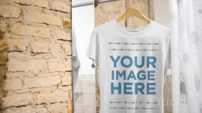 Round Neck Tee Video Mockup Hanging in a Changing Room a13140