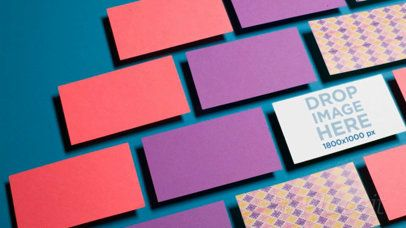 Business Card Video Lying on a Solid Surface with other Business Cards around It a13962