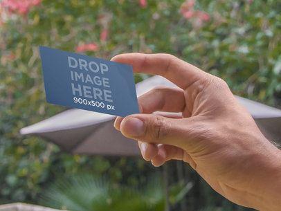 Holding Business Card On Backyard 7836
