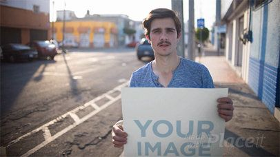 Dude Sticking a Poster to a Wall In The Street Stop Motion Mockup a13659