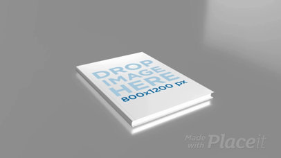 Video of a Hardcover Book Lying on a Flat Gray Surface a16043b