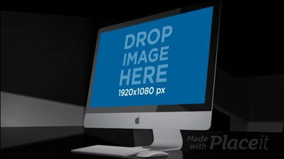 iMac Standing on a Dark Surface Video Mockup a15964b